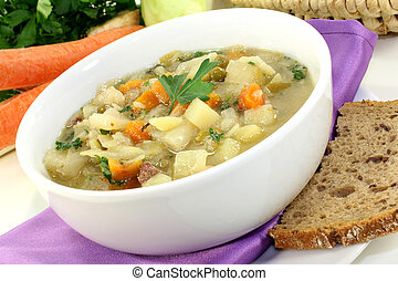Cabbage soup - a bowl of cabbage soup and fresh parsley