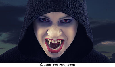 angry woman vampire against the dark sky