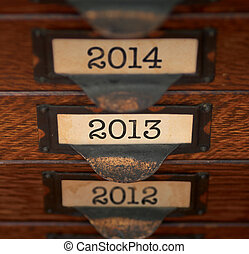 Retro Focus on 2013 - Stack of old, oak flat file drawers...