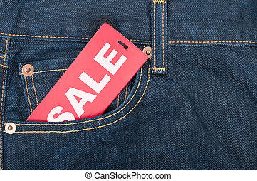 Sale Tag - Red Sale Tag in Pocket of Blue Jeans
