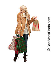 woman with shopping bags - picture of lovely woman with...
