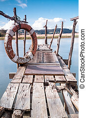 Gangway over the water and a lifebuoy - A gangway over the...