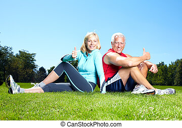 Fitness couple - Happy senior fitness couple in the park