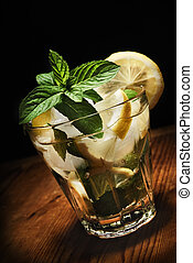Mojito cocktail on rustic wooden background