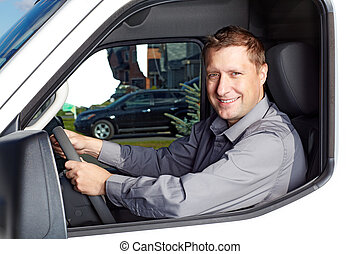 Handsome truck driver - Smiling truck driver in the car...