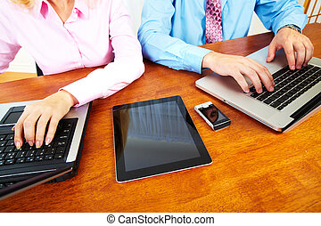 Business people group working with laptop. - Hands of people...