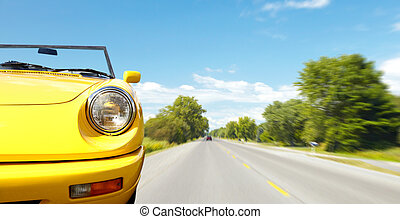Retro car on the road. - Yellow beautiful Retro car on the...