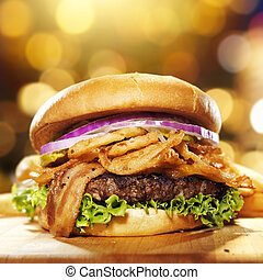 gourmet bacon hamburger with golden background and copy...