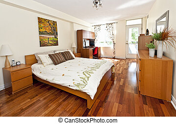 Bedroom interior with hardwood floor - artwork is from...