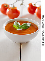 tomato soup with basil garnish and copyspace composition