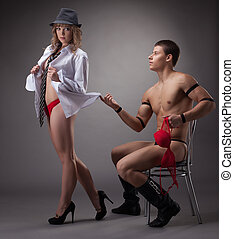 sexy girl in red lingerie play with striptease man - sexy...