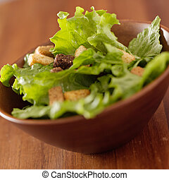 simple salad with leafy greens and croutons.