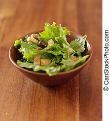 simple salad of leafy greens and croutons with copyspace...