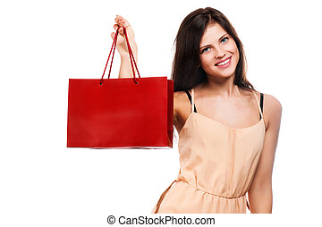 Young woman with shopping bags over