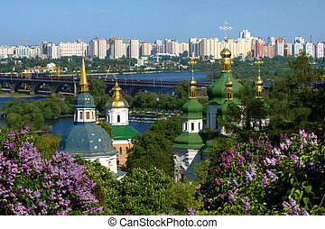 Springtime in Kiev - Lilac bushes with Vidubichi monastery,...