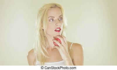 Beautiful blonde woman playing