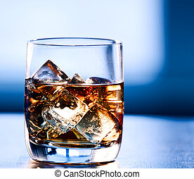 Highball glass of alcohol with ice
