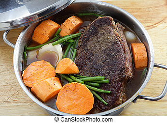 Pot roast with sweet potato - A traditional American...