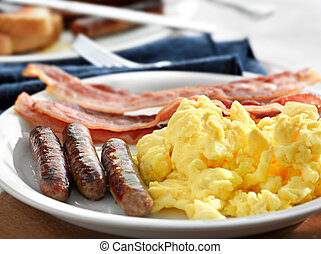 breakfast meal with sausage and scrambled eggs with bacon