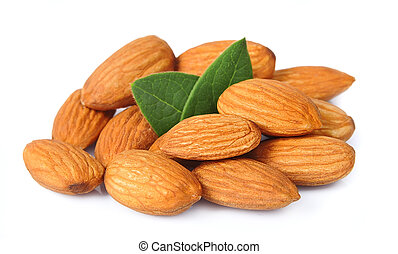 Seed of almonds nuts with leavs on white