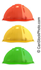 Three construction helmets colored as traffic light,...