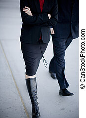 Business people walking - Two business people walking...