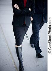 Business people walking - Two business people walking...