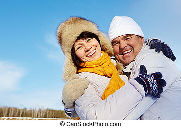 Togetherness - Portrait of happy mature couple in winter...