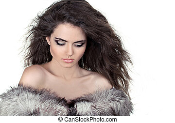 Attractive woman in fur coat isolated on white background