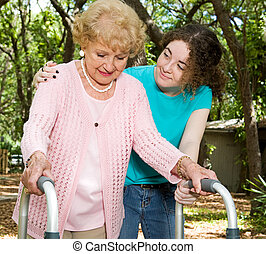 Teen Volunteers with Senior - Teen girl helping a senior...