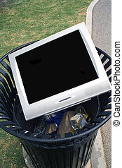 TV Trash - Television or Monitor laying in a trash can