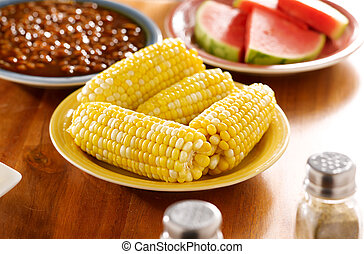 meal with corn on the cob on a plate