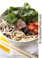 Vietnamese Beef Pho - Bowl of Vietnamese beef pho, with...