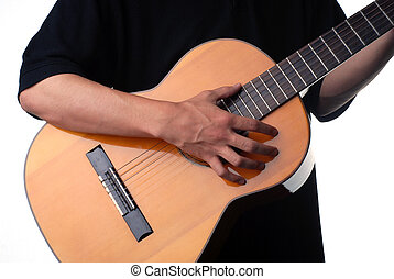 Accoustic player - Shot of a male hand strumming guitar...