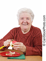 Healthy eating - Portrait of a smiling senior woman eating...