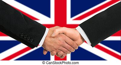 The British flag and business handshake