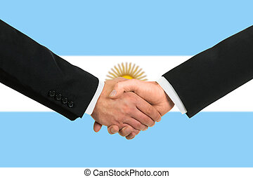 The Argentine flag and business handshake