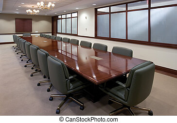 Conference Room - large empty meeting room with wood table