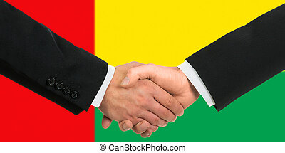 The Guinea-Bissau Flag and business handshake