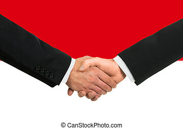 The Indonesian flag and business handshake