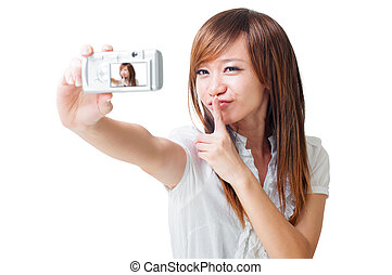 Self photographing - Asian girl self photographing, isolated...