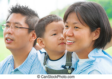 Happy Asian family at outdoors
