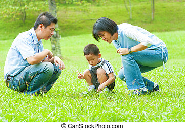 Asian family - Candid Asian family at outdoors