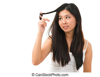 Damaged dry hair - Portrait of Asian woman holding damaged...