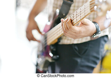 Man playing guitar - Hands playing electric guitar, focus on...