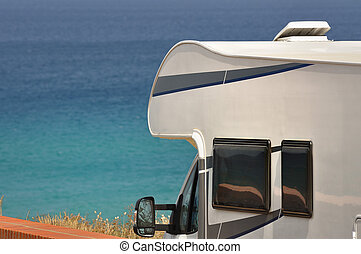 Camper van on the beach, closeup