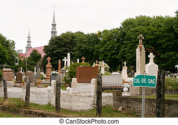 Cemetery Irony - A street sign juxtaposed near a Quebec...