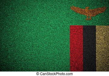 The Zambian flag painted on a cork board.