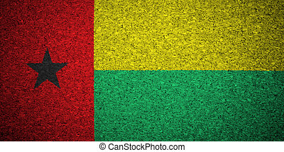 The Guinea-Bissau Flag painted on a cork board.