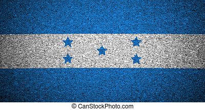 The Honduran flag painted on a cork board.
